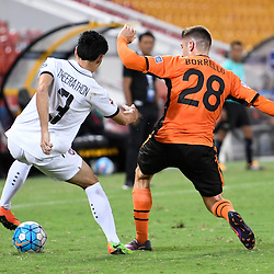 BRISBANE, AUSTRALIA - FEBRUARY 21: Brandon Borrello of the Roar and Theerathon Bunmathan of Muangthong United in action during the Asian Champions League Group Stage match between the Brisbane Roar and Muangthong United FC at Suncorp Stadium on February 21, 2017 in Brisbane, Australia. (Photo by Patrick Kearney/Brisbane Roar)
