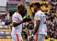 Blackpool's Armand Gnanduillet celebrates scoring his side's third goal with Michael Nottingham<br /> <br /> Photographer Alex Dodd/CameraSport<br /> <br /> The EFL Sky Bet League One - Bradford City v Blackpool - Saturday 23rd March 2019 - Valley Parade - Bradford <br /> <br /> World Copyright © 2019 CameraSport. All rights reserved. 43 Linden Ave. Countesthorpe. Leicester. England. LE8 5PG - Tel: +44 (0) 116 277 4147 - admin@camerasport.com - www.camerasport.com
