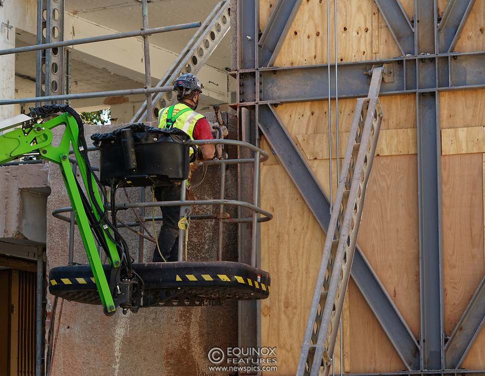 London, United Kingdom - 20 September 2019<br /> EXCLUSIVE SET - Aerial construction specialists and demolition experts use a huge crane to carefully lift intact, a twenty five ton, two-story wall, to preserve a famous Banksy rat image which has been covered up for years. Teams from specialist companies have spent over six weeks cutting around the artwork and fitting custom made eight ton steel supports to enable them to save the historic piece of art. Work has started on the construction of a new twenty seven floor art'otel hotel on the site of the old Foundry building in Shoreditch, east London, and a condition of the planning permission was to preserve the historical Banksy graffiti. A second section of the painting, an image of a TV being thrown through a broken window has already been cut out and moved separately. After the hotel construction is complete the two parts of the Banksy painting will be displayed on the hotel. Our pictures show the stages of work to protect the image, culminating in the lifting of the three story wall by crane. Video footage also available.<br /> (photo by: EQUINOXFEATURES.COM)<br /> Picture Data:<br /> Photographer: Equinox Features<br /> Copyright: ©2019 Equinox Licensing Ltd. +443700 780000<br /> Contact: Equinox Features<br /> Date Taken: 20190920<br /> Time Taken: 13281700<br /> www.newspics.com
