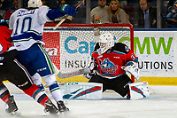 KELOWNA, BC - OCTOBER 16:  Cole Schwebius #31 of the Kelowna Rockets makes a first period save against the Swift Current Broncos at Prospera Place on October 16, 2019 in Kelowna, Canada. (Photo by Marissa Baecker/Shoot the Breeze)