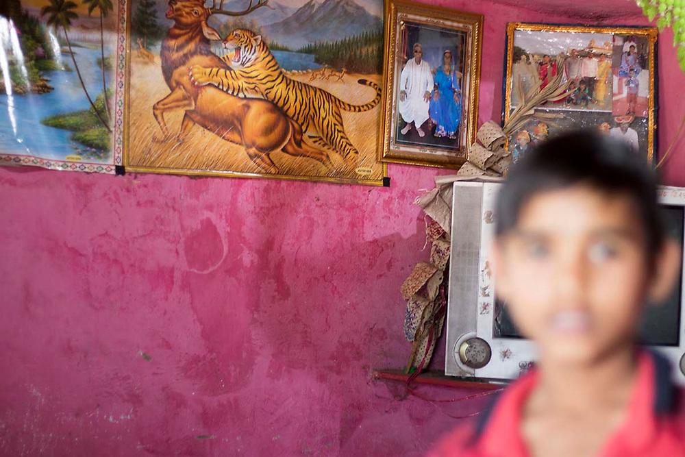 Sondhabi_ a mathura laman house with a poster of a tiger.