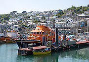 RNLI lifeboat in the harbour of fishing port of Newlyn, Cornwall, England, UK
