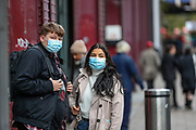 People wearing face surgical masks to protect themselves and help to curb the spread of Coronavirus Pandemic Outbreak, walk by Waterloo Underground station in central London on Wednesday, Oct 14, 2020. The UK has recorded 12,872 more coronavirus cases and 65 deaths in the latest daily government update. It marks a slight fall from last Saturday when 15,166 cases and 81 deaths were recorded. The UK's coronavirus death toll now stands at 42,825. (VXP Photo/ Vudi Xhymshiti)