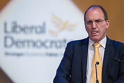 © Licensed to London News Pictures . 04/10/2014 . Glasgow , UK . SIMON HUGHES , Minister of State at the Ministry of Justice , delivers his speech to the conference . The Liberal Democrat Party Conference 2014 at the Scottish Exhibition and Conference Centre in Glasgow . Photo credit : Joel Goodman/LNP