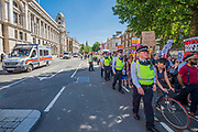 The protest moved down Whitehall with a large Police cordon and tail of vehicles - A day after the election result protestors gather to ask for Theresa May to quit and not do a deal with the DUP. Who people fear because of their views on abrtion, gay marriage etc. Westminster, London, 10 Jun 2017