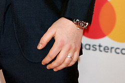 Ed Sheeran, complete with a ring on his wedding finger, is seen arriving at the 2018 Brit Awards at the O2 in London.<br /><br />21 February 2018.<br /><br />Please byline: Vantagenews.com