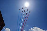 French national air force flying over in formation emitting their national colors