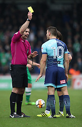 Wycombe Wanderers' Matt Bloomfield is shown the yellow card during the Emirates FA Cup, second round match at Adams Park, Wycombe.