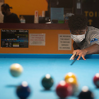 Saleem Gillespie, 16, practices pool Tuesday evening at Q & A Billiards in Gallup. He is learning competitive billiards from Gina Kim, the owner of Q&A Billiards.