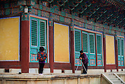 Tourists visiting the Pulguksa Temple in South Korea pause to take photographs of each other