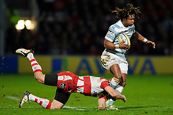 London Irish Winger (#11) Marland Yarde is tackled by Gloucester Outside Centre (#13) Mike Tindall (capt) during the second half of the match - Photo mandatory by-line: Rogan Thomson/JMP - Tel: Mobile: 07966 386802 05/01/2013 - SPORT - RUGBY - Kingsholm Stadium - Gloucester. Gloucester Rugby v London Irish - Aviva Premiership.