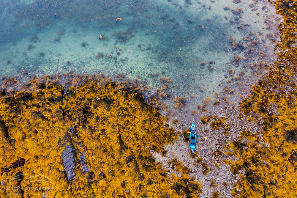An aerial view of a kayak on the shore of Little Whaleboat Island in Maine's Casco Bay. Low tide.