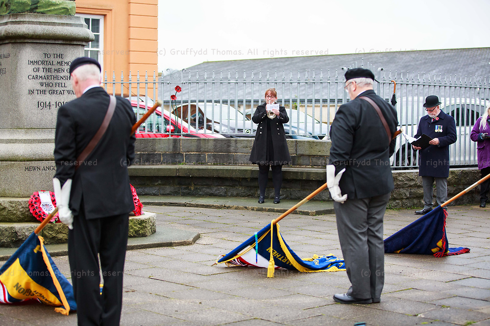 """Carmarthen, Carmarthenshire, Wales, UK. 8 November, 2020.<br /> Due to Covid-19 """"fire break"""" restrictions, a scaled-back Remembrance Day parade in Carmarthen, Carmarthenshire, west Wales. The Last Post is played by a trumpeter.<br /> Credit: Gruffydd Ll. Thomas"""