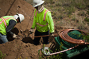 Construction workers connect fresh water piping as part of the Carnuel Water Systems Improvement Project on August 27, 2010. The $3.4 million project is supported by $2 million from the American Recovery and Reinvestment Act and will provide clean water to hundreds of Bernalillo County residents.