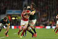 Alex Cuthbert of Wales is stopped by Lodewyk De Jager of South Africa. Rugby World Cup 2015 quarter final match, South Africa v Wales at Twickenham Stadium in London, England  on Saturday 17th October 2015.<br /> pic by  John Patrick Fletcher, Andrew Orchard sports photography.