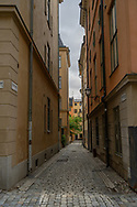 Stockholm, Sweden -- July 16, 2019. Vertical photo of a  long and empty alleyway  in Old Town, Stockholm.