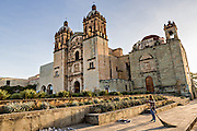 Church of Santo Domingo de Guzmán in the historic district with a street sweeper cleaning the plaza October 30, 2013 in Oaxaca, Mexico.