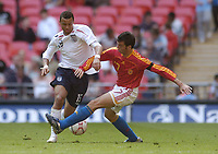 Photo: Olly Greenwood.<br />England U16 v Spain U16. International Friendly. 28/04/2007. England's John Bostock and Spain's Fernando Ruiz Izaguirre