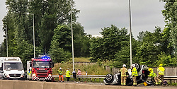 Pictured:<br /> Five fire engines and associated services attended a serious RTA on the nothrbound M80 outside Cumbernauld.<br /> <br /> Russell Sneddon EEm; 14 July 2021