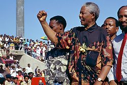 NELSON ROLIHLAHLA MANDELA (July 18, 1918 - December 5, 2013), 95, world renown civil rights activist and world leader. Mandela emerged from prison to become the first black President of South Africa in 1994. As a symbol of peacemaking, he won the 1993 Nobel Peace Prize. Joined his countries anti-apartheid movement in his 20s and then the ANC (African National Congress) in 1942. For next 20 years, he directed a campaign of peaceful, non-violent defiance against the South African government and its racist policies and for his efforts was incarcerated for 27 years. Remained strong and faithful to his cause, thru out his life, of a world of peace. Transforming the world, to make it a better place. PICTURED: 1994. - Bophuthatswana, South Africa - NELSON MANDELA is greeted jubilantly by supporters in 1994 during his election campaign that spanned the country and saw him win the first ever democratic non-racial elections in South Africa.  (Credit Image: © Greg Marinovich/ZUMA Wire/ZUMAPRESS.com)