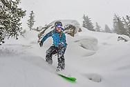 Jeremy Swanson rides through fresh powder on Rock Island at Snowmass.