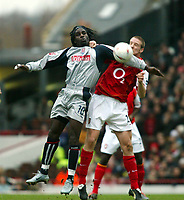 Photo. Chris Ratcliffe, Digitalsport<br /> Arsenal v Stoke City. FA Cup Third Round. <br /> 09/01/2005<br /> Ade Akinbiyi of Stoke and Phillippe Senderos of Arsenal tussle for this one.