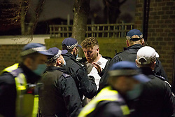 © Licensed to London News Pictures.17/12/2020. London, UK. Police disperse large numbers of street drinkers in Hackney Wick, east London. As London is in Tier 3 since Wednesday, members of the public are not allowed to meet socially indoor and outdoor with people from different households. Photo credit: Marcin Nowak/LNP
