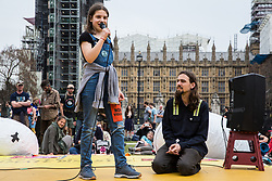 London, UK. 23rd April 2019. A 12-year-old school striker addresses climate change activists from Extinction Rebellion at an assembly in Parliament Square to discuss the preparation and delivery of activists' letters requesting meetings to discuss climate change with Members of Parliament.