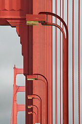 Road Lighting Fixtures and the Two Tower in Background. A Walk across The Golden Gate Bridge.