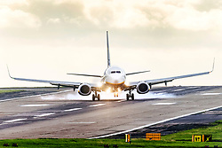 © Licensed to London News Pictures. 23/09/2021. Leeds UK. A Ryanair aircraft arriving from Krakow struggles to land in strong winds at Leeds Bradford International Airport this morning. Photo credit: Andrew McCaren/LNP