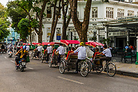 Cyclos (three wheeled bicycle taxis) in the Old Quarter, Hanoi, northern Vietnam.
