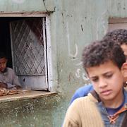 Young shopkeeper looks on. Dahab Island, Cairo.