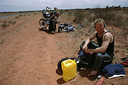 Motorcycle breakdown on Stuart Highway, south of Alice Springs. Shot during the Pentax Solar Car Race.