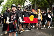 Protesters have been marching peacefully through the city in groups of 100 as part of an Invasion Day rally. The Australia Day protest went ahead despite coronavirus rules limiting gatherings to 100 people. (Photo by Michael Currie/Speed Media)