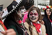 High School students compete in a Catrina Day of the Dead costume contest during Día de los Muertos festival October 31, 2017 in Patzcuaro, Michoacan, Mexico.