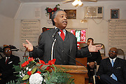 Rev Shaarpton gestures as he speaks during services at the Antioch Baptist Church in Jena Luoisian Sunday jan. 20,2008. The town of Jena Louisiana rescheduled their Martin Luther King Holiday festivities from Monday to Sunday because the Nationalist Movement planned a march in Jena on MLK day. Reverand Al Sharpton speaks Sunday Jan. 20,2008 at the Antioch Baptist Church in Jena Louisiana. Sharpton came to Jena the day before Martin Luther King holiday because the Nationalist Movement lead by Richard Barrett is to march on Jena Monday during MLK holiday. The Nationalist movement is coming to Jena in response to the Jena 6 rally last year. Sharpton was in Jena to protest the Jim Crow Justice still prevalent in the south. Sharpton discussed his feeling about MLK's legacy and how it should be celebrated and that their are still, today in the South many things to fight for, Equal Justice would be at the top of his list. Sharpton said you can not heal the community until justice is dealt with fairly, no white justice or black  justice -Equal Justice for all is what will heal the town of Jena.(Photo/© Suzi Altman)