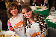 Unidentified guests pose for a portrait during the Milpitas Chamber of Commerce 21st Annual Auction & Crab Feed at Napredak Hall in San Jose, California, on March 7, 2014. (Stan Olszewski/SOSKIphoto)