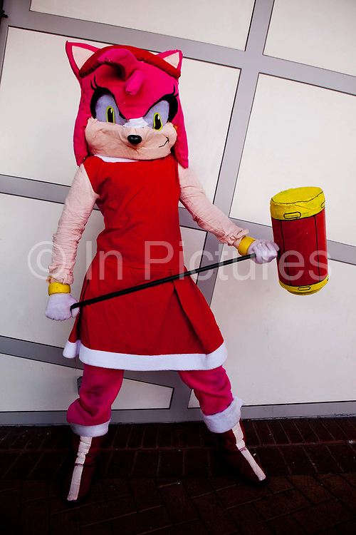 Amy Rose from Sonic the Hedghog (Josh Borg) attending the London Film and Comic Con LFCC is a convention held annually in London that focuses on films, cult television and comics. The convention holds a large dealers hall selling movie, comic and science fiction related memorabiliaand original film props, along with free guest talks, professional photoshoots, autograph sessions, displays. Many of the visitors / attendeesarrive dressed up as their favourite comic and sci-fi characters in the most outlandish costumes which draws from the award-winning formula of innovative gameplay.<br /> Sonic the Hedgehog, trademarked Sonic The Hedgehog, is a video game character and the main protagonist of the Sonic video game series released by Sega, as well as in numerous spin-off comics, cartoons, and a feature film.