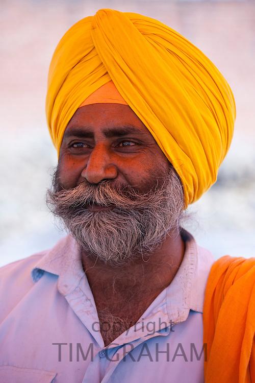Sikh Indian man wearing traditional turban at Bharatpur, Northern India