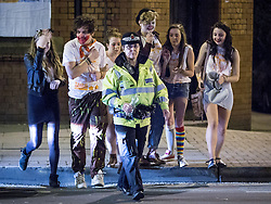 © Licensed to London News Pictures . 17/11/2013 .  Manchester , UK . Police confiscate drinks from students , in the street . Students from Manchester's Universities take part in the annual Carnage pub crawl event at bars in the city's Deansgate Locks venue . Photo credit : Joel Goodman/LNP