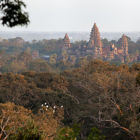 View over the Angkor Wat area from the top of Phnom Bakheng. The ascension of Phnom Bakheng was joyless because of the hundreds of tourists - some of them riding on an elephant, trying to reach the top before sunset.