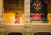 VARANASI, INDIA - CIRCA NOVEMBER 2016: Portrait of a man worshiping in Varanasi. Varanasi is the spiritual capital of India, the holiest of the seven sacred cities.