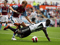 Photo: Rich Eaton.<br /> <br /> Aston Villa v Newcastle United. The Barclays Premiership. 27/08/2006. Olof Mellberg right of Aston Villa tackles Obefami Martins, Newcastles new signing