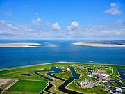Nederland, Noord-Holland, gemeente Den Helder, 07-05-2021; Huisduinen met Fort Erfprins (Marinekazerne). Zicht op het Marsdiep en vaargeul het Molengat tussen Noorderhaaks en De Hors (Texel, rechts).<br /> Huisduinen with Fort Erfprins (Naval Barracks). View of the Marsdiep and the Molengat navigation channel between Noorderhaaks and De Hors (Texel, right).<br /> <br /> luchtfoto (toeslag op standard tarieven);<br /> aerial photo (additional fee required)<br /> copyright © 2021 foto/photo Siebe Swart