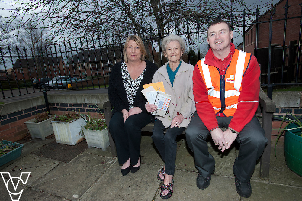 Pictured, from left, flat warden Lindsey Leonardi, Rena Barker, and postman James Clarke-Hogg.<br /> <br /> ---<br /> <br /> A Nottinghamshire postman came to the rescue of an elderly woman who was victim to scam mail has received an award from Trading Standards for his efforts.<br /> <br /> James Clarke-Hogg, from Gaisdale Parkway delivery office, has been working for the business for nearly 30 years and could see all the signs when he was delivering excessive amounts of mail to Rena Barker at her warden-aided flat complex.<br /> <br /> Date: January 26, 2015