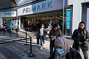 With local coronavirus lockdown measures in place and Birmingham currently set at 'Tier 2' or 'high', people, many of whom are wearing face masks leave the flagship Primark store in the city centre on 26th October 2020 in Birmingham, United Kingdom. The three tier system in the UK has levels: 'medium', which includes the rule of six, 'high', which will cover most areas under current restrictions; and 'very high' for those areas with particularly high case numbers. Meanwhile there have been calls by politicians for a 'circuit breaker' complete lockdown to be announced to help the growing spread of the Covid-19 virus.