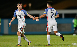 October 10, 2017 - Couva, Caroni County, Trinidad & Tobago - Couva, Trinidad & Tobago - Tuesday Oct. 10, 2017: Christian Pulisic and DeAndre Yedlin celebrate CP's goal during a 2018 FIFA World Cup Qualifier between the men's national teams of the United States (USA) and Trinidad & Tobago (TRI) at Ato Boldon Stadium. (Credit Image: © John Todd/ISIPhotos via ZUMA Wire)