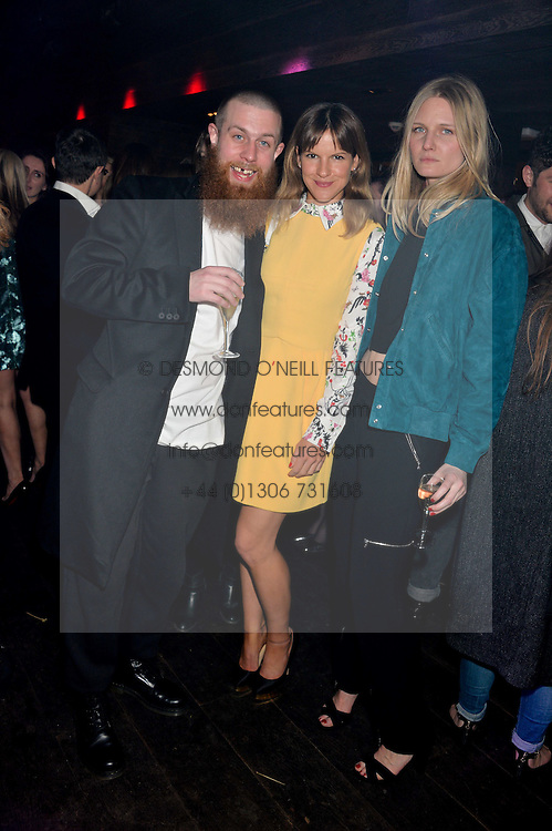 Left to right, KIM TRAGER, FUSCHIA KATE SUMNER and LOWELL DELANEY at the Lancôme pre BAFTA party held at The London Edition, 10 Berners Street, London on 14th February 2014.