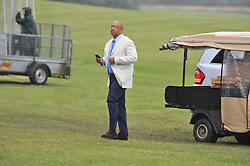 PRINCE SEEISO OF LESOTHO (in white) at the Sentebale Polo Cup held at Coworth Park, Berkshire on 12th June 2011.