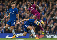 Football - 2017 / 2018 Premier League - Chelsea vs Manchester City<br /> <br /> Raheem Sterling (Manchester City) tries to squeeze through the gap between Marcos Alonso (Chelsea FC)  and Tiemoue Bakayoko (Chelsea FC) at Stamford Bridge <br /> <br /> COLORSPORT/DANIEL BEARHAM